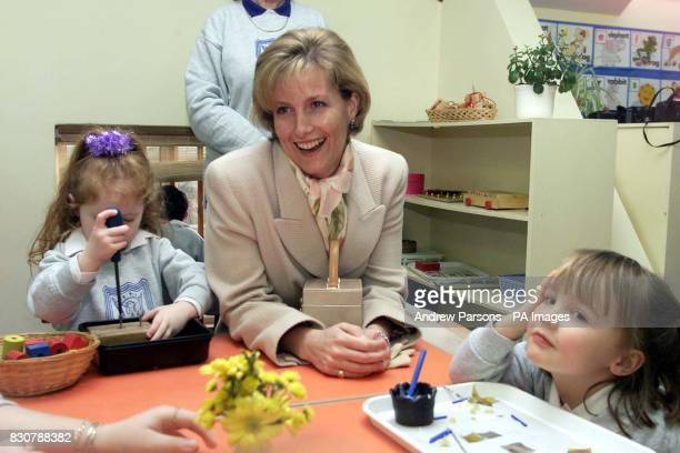 The Countess of Wessex enjoys the fun with the childen Lorna Caseley four and Emily Bilby four during her visit to the Phoenix Montessori Nursery...