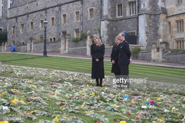 The Countess of Wessex, Lady Louise Windsor and the Earl of Wessex view flowers outside St George's Chapel, at Windsor Castle, Berkshire, following...