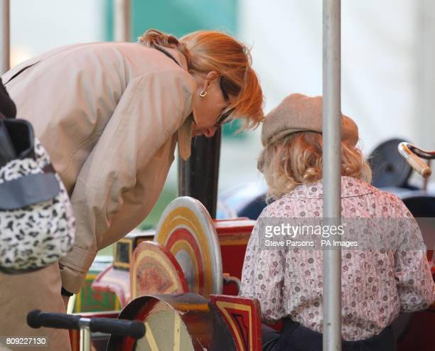 The Countess of Wessex with her daughter Lady Louise Windsor as she enjoys a fairground ride at the Royal Windsor Horse show Windsor