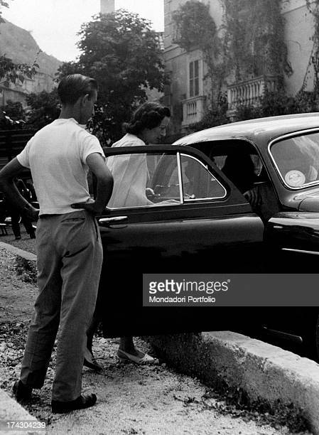 The Countess Pia Bellentani gets into a car to go to Rocca Pia She is coming out from the psychiatric hospital where she was imprisoned for the...