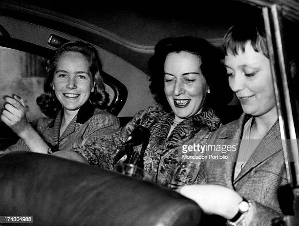 The Countess Pia Bellentani sitting on the back seat of a car smiles with her daughters Clavia and Stefania She is coming out from the psychiatric...