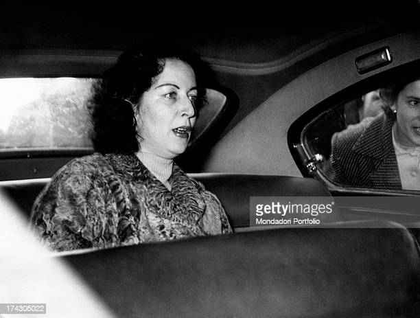 The Countess Pia Bellentani sitting on the back seat of a car to go home to Sulmona She is coming out from the psychiatric hospital where she was...
