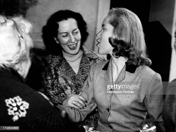 The Countess Pia Bellentani talks and smiles with her daughter and a guard of the institute of Female Boarding Schools where she was held for the...