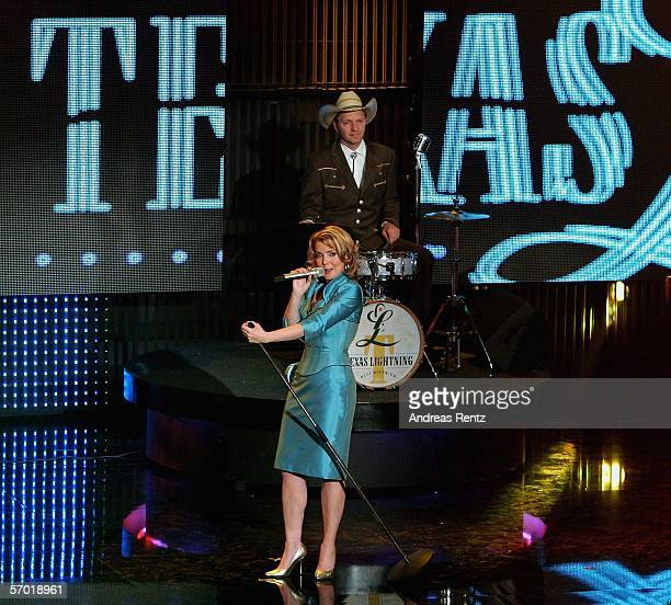 The country band 'Texas Lightning' with singer Jane Comerford and drummer Olli Dittrich perform on stage during a preview of the German elimination...