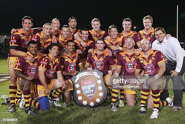 The Country Origin team pose with the trophy after their victory in the NRL City v Country Origin match at Apex Oval May 12 2006 in Dubbo Australia