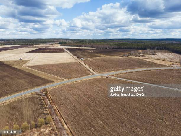 the country roads cross in the middle of the fields at the rural finland. - heinovirta stock pictures, royalty-free photos & images