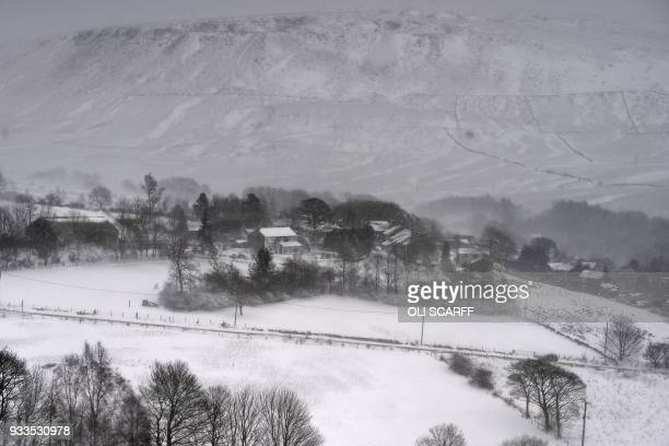 The countryside blanketed in snow near the village of Diggle east of Manchester in northern England on March 18 as the wintry weather makes a return...