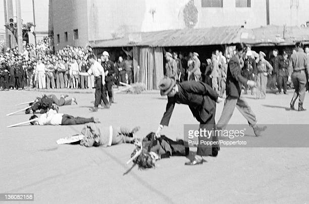 The coup de grace moments after five Chinese prisoners were executed for economic racketeering in Shanghai circa May 1949 Attached to each prisoner...