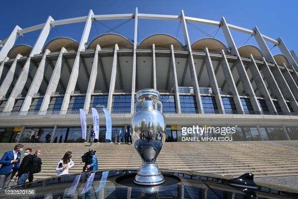 The Coupe Henri Delaunay, the trophy of the UEFA European Football Championship is pictured in front of the National Arena stadium, the venue to host...