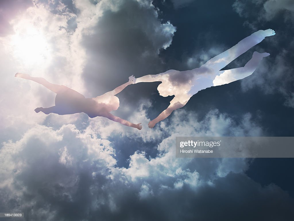 The couple made of clouds are flying in the sky : Stock Photo