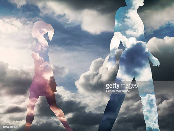 The couple made of clouds are separating in the sk