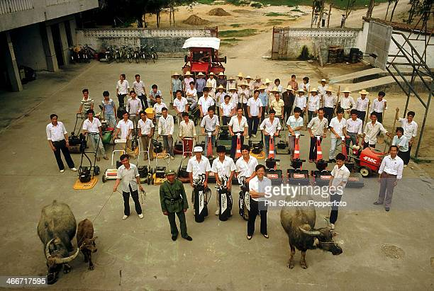 The course maintenance team including the greenkeepers three golf professionals and two water buffalo at the Chung Shan Hot Springs Golf Course in...