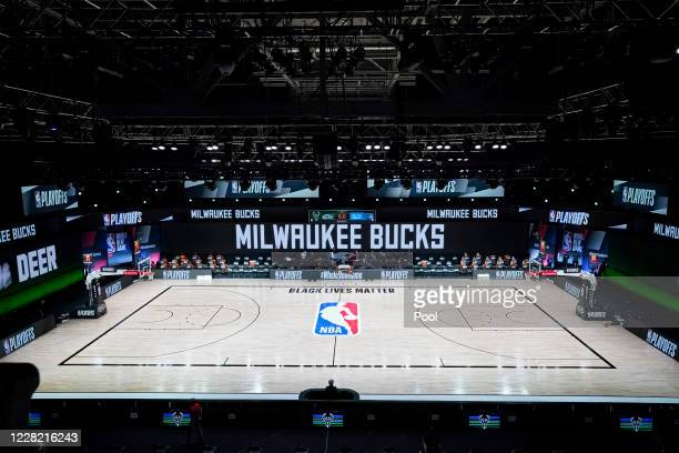 The court and benches are empty after the scheduled start of game five between the Milwaukee Bucks and the Orlando Magic in the first round of the...