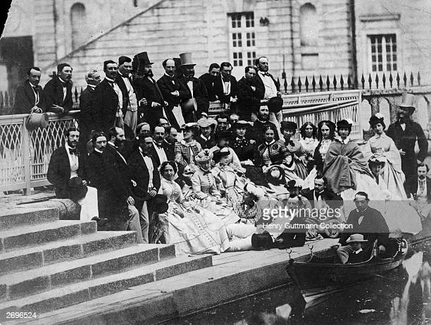 The court of Napoleon III at Fontainebleau The Emperor is in the boat with his son Eugene the Prince Imperial Empress Eugenie is third from left in...