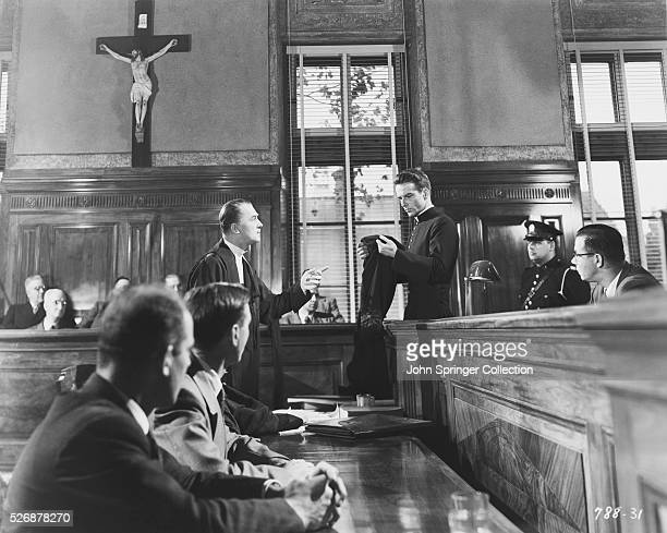 The courtroom scene from Alfred Hitchcock's 1953 film I Confess, starring Montgomery Clift as Michael Logan and Brian Aherne as Willy Robertson.
