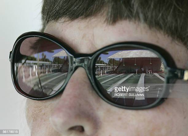 The courts of the St Petersburg Shuffleboard Club are reflected in a member's sun glasses during a tournament at the fasility 13 November 2005 in St...