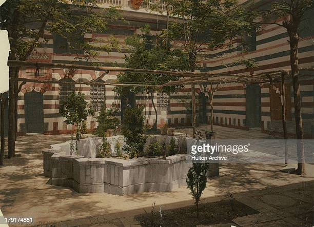 The courtyard of a house in Damascus Syria circa 1880 A colorised photograph