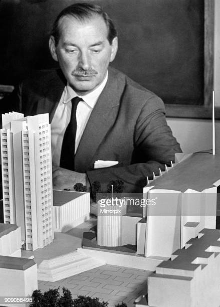 The Coventry City Architect, Mr Arthur Ling, studies a model of his new design for the Lanchester College's proposed Hall of Residence, showing its...