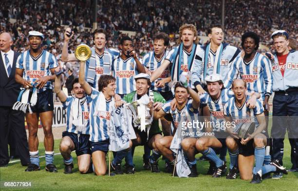 The Coventry City squad celebrate with the trophy after the 1987 FA Cup Final between Coventry City and Tottenham Hotspur at Wembley Stadium on May...