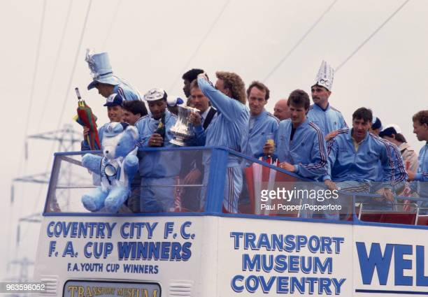 The Coventry City team on an open-top bus parade after winning the FA Cup on May, 16 1998 in Coventry, England. Identified at the front of the bus...