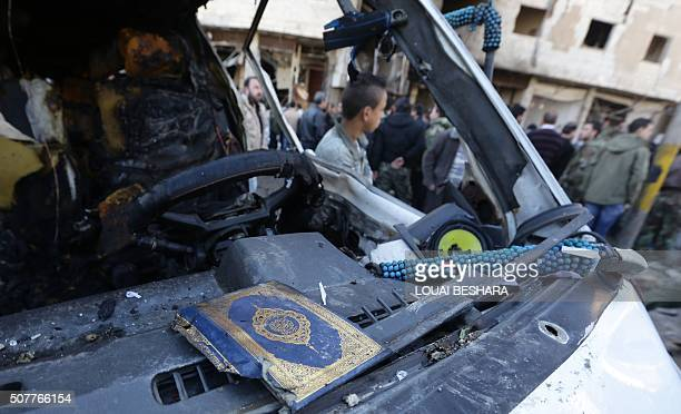 The cover of a Koran Islam's holy book is seen in the wreckage of a car following suicide bombings in the area of a revered Shiite shrine in the town...