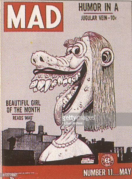 The cover of issue of Mad magazine shows a cartoon byBVasil Wolverton of a smiling woman with a pockmarked face and giant teeth accompanied by the...