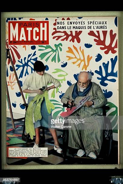 The cover of 'Paris Match' magazine No294 from the 13th20th November 1954 French artist Henri Matisse and his assistant creating découpage foliage at...
