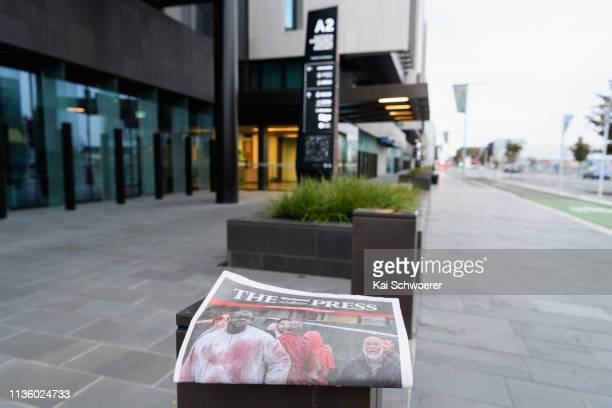 The cover of the local newspaper The Press is seen in front of Christchurch District Court where the suspected shooter Brenton Tarrant is due to...