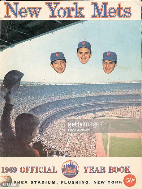 The cover of the New York Mets baseball team Yearbook features a photograph of Shea Stadium as the disembodied heads of Met's players Jerry Koosman...