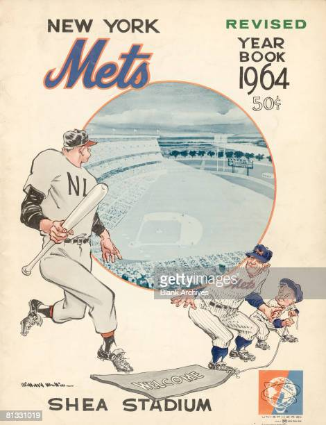 The cover of the New York Mets baseball team Yearbook features the team's logo and an illustration of two Mets players as they hide and prepare to...