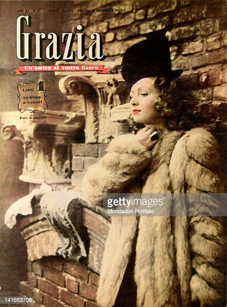 The cover of the women's magazine Grazia showing a young woman leaning on a wall 1930s