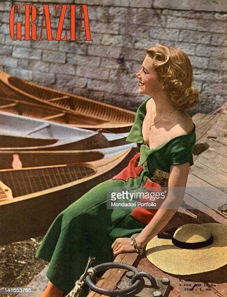 The cover of the women's magazine Grazia showing a young woman sitting on a marina's quay. 1940s