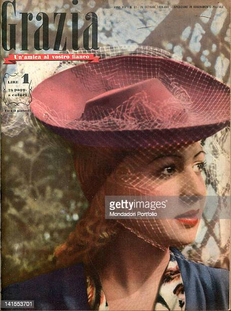 The cover of the women's magazine Grazia showing a young woman wearing a hat with veil. 1930s