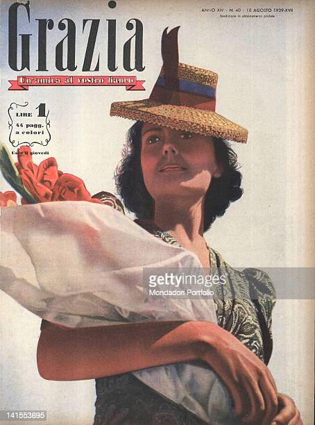 The cover of the women's magazine Grazia showing a young woman with a hat and a bunch of flowers. 1930s