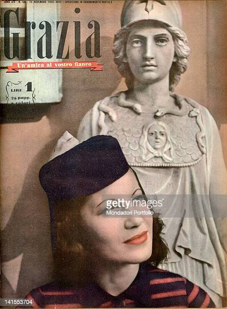 The cover of the women's magazine Grazia showing a young woman with a statue behind her back 1930s