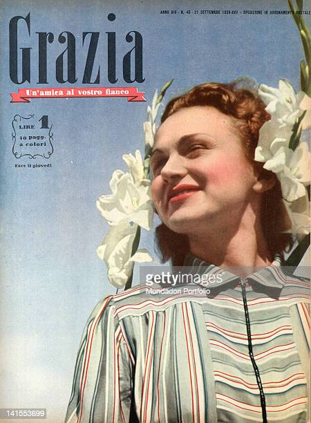 The cover of the women's magazine Grazia showing a young woman's smiling face. 1930s