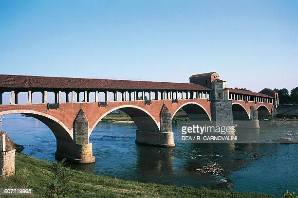 The covered bridge over the Ticino river built in 1949 to the original 14th century structure Pavia Lombardy Italy