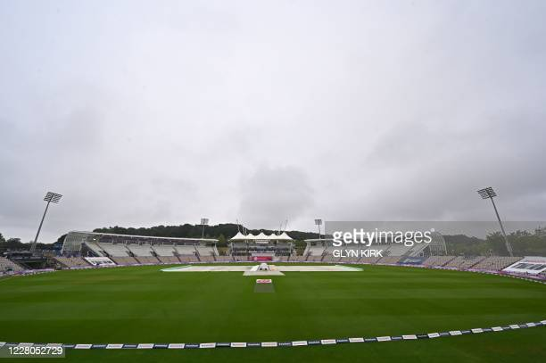 The covers are on as the start of play is delayed on the third day of the second Test cricket match between England and Pakistan at the Ageas Bowl in...