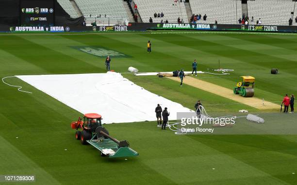 The covers come off the pitch during the International Twenty20 match between Australia and India at Melbourne Cricket Ground on November 23 2018 in...