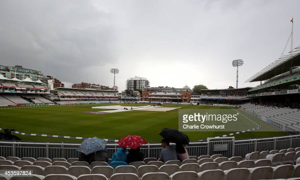 The covers come on as rain stops play during the Royal London OneDay Cup match between Middlesex Panthers and Nottinghamshire Outlaws at Lord's...