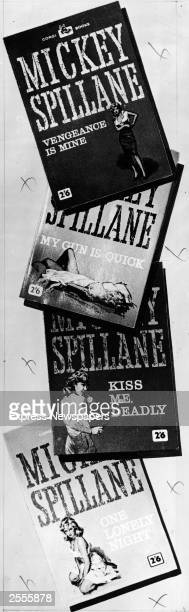 The covers of four novels by American writer Mickey Spillane all depicting women in sexy poses 'Vengeance Is Mine' 'My Gun Is Quick' 'Kiss Me Deadly'...