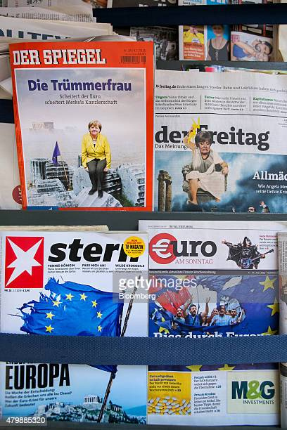 The covers of weekly German news magazines Der Spiegel Der Freitag Stern and Euro am Sonntag report on the ongoing financial crisis in Greece as they...