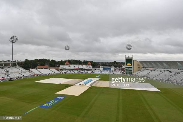 The covers remain on the pitch as rain threatens to delay the start of play on the fifth day of the first Test match between England and India at the...