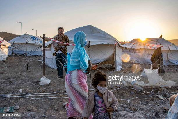 The Covid-19 quarantine area with fences made of barbed wire for the Coronavirus positive cases in the new refugee camp in Kara Tepe - Mavrovouni a...