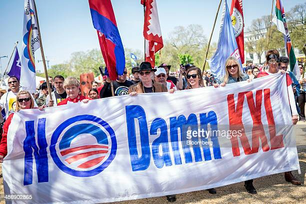 The Cowboy and Indian Alliance marches with rock icon Neil Young center and actress and environmentalist Daryl Hannah second from right to the...