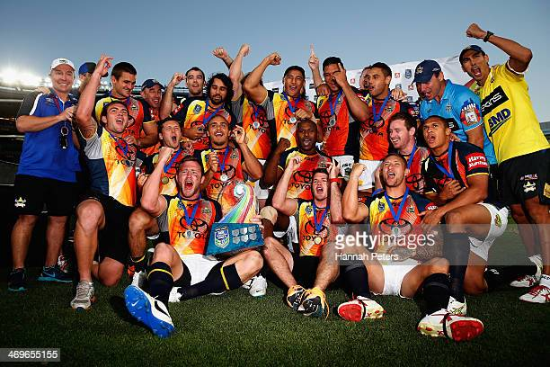 The Cowboys celebrate after winning the grand final match between the Brisbane Broncos and the north Queensland Cowboys in the Auckland NRL Nines at...