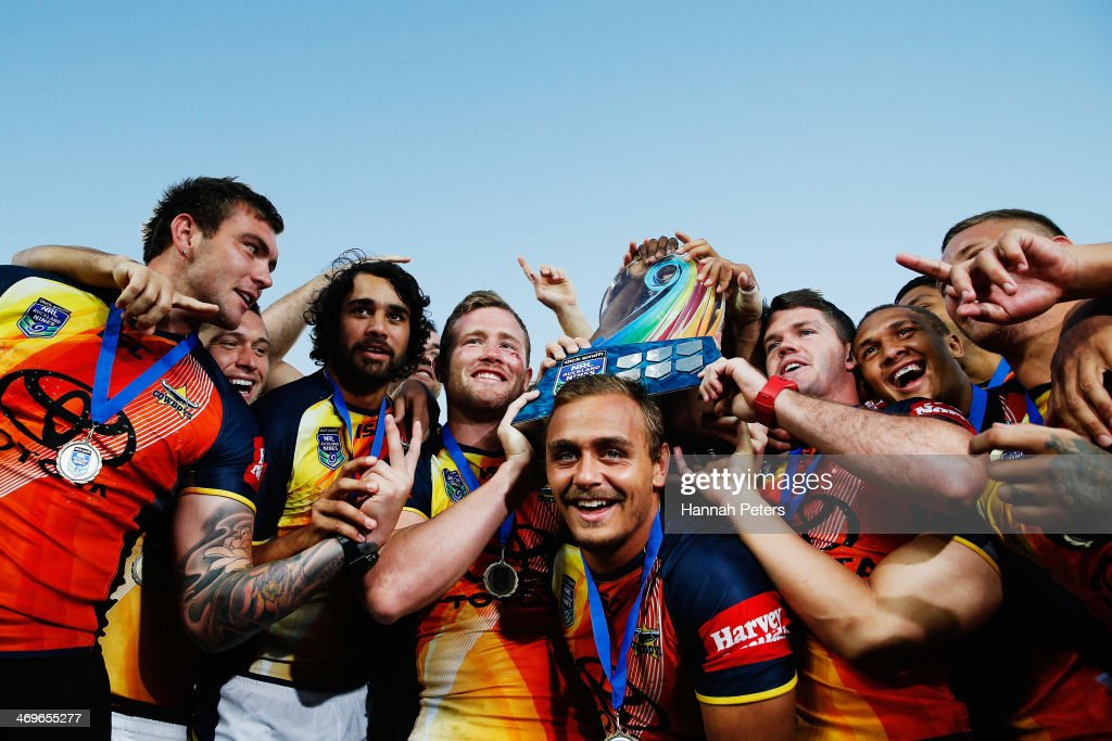 The Cowboys celebrate after winning the grand final match between the Brisbane Broncos and the north Queensland Cowboys in the Auckland NRL Nines at Eden Park on February 16, 2014 in Auckland, New Zealand.