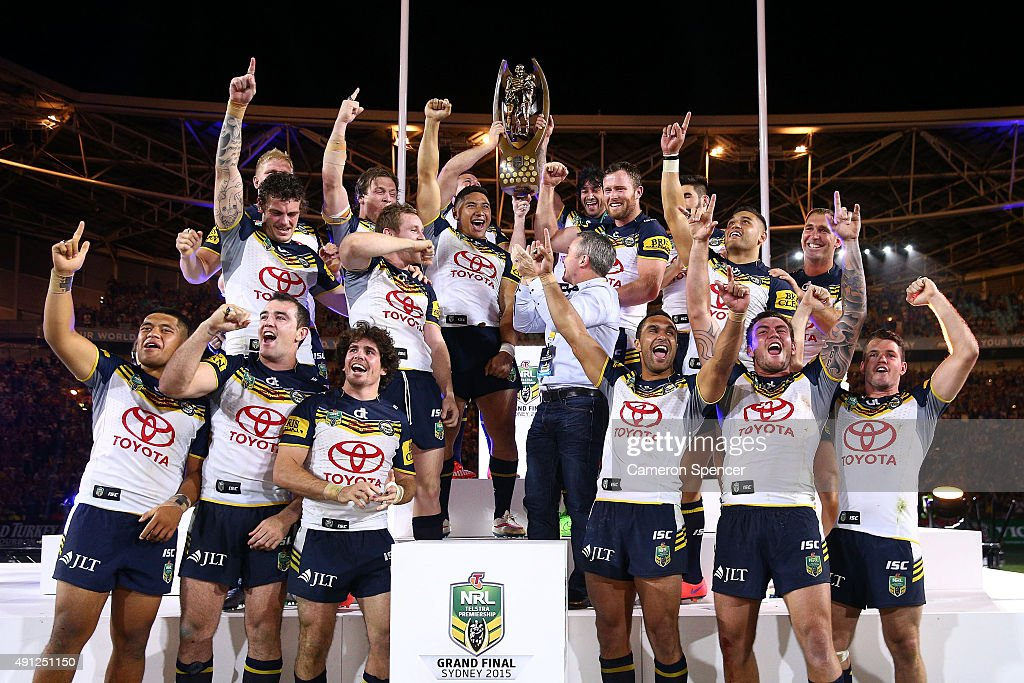 The Cowboys celebrate on the podium with the premiership trophy after winning the 2015 NRL Grand Final match between the Brisbane Broncos and the North Queensland Cowboys at ANZ Stadium on October 4, 2015 in Sydney, Australia.