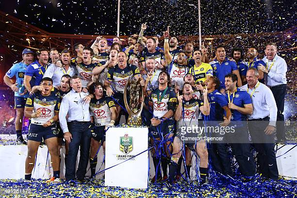 The Cowboys celebrate on the podium with the premiership trophy after winning the 2015 NRL Grand Final match between the Brisbane Broncos and the...