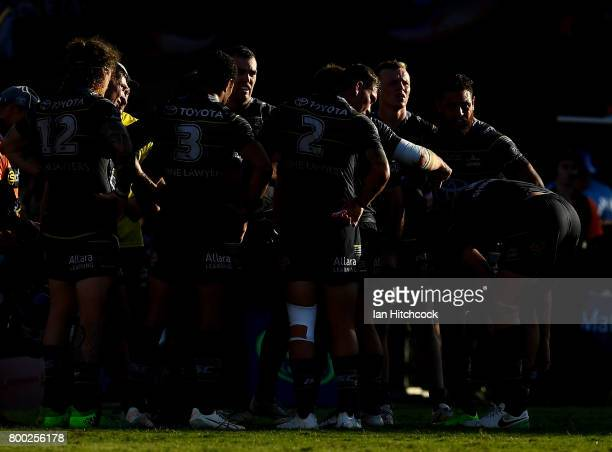The Cowboys stand together waiting for a conversion attempt during the round 16 NRL match between the North Queensland Cowboys and the Penrith...